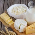 Fresh dairy products. Milk, cheese, butter and cottage cheese wi