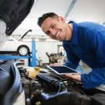 Mechanic using tablet on car