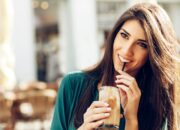 Beautiful woman drinking coffee in a cafe outdoors