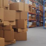 Cardboard Boxes In Middle Of The Warehouse, Logistic Center. Hug
